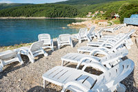 Pebble beach with chaise-longues in Istria