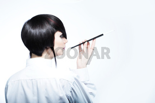 Young woman with fashion haircut holding a cigarette holder, on white