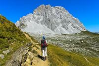 Hiker in front of the peak Sulzfluh, St. Antönien, Prättigau, Graubünden, Grisons, Switzerland