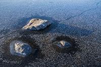 Stones in a frozen lake, Lapland, Sweden