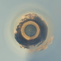 Little planet 360 degree sphere. Panoramic view of sunrise above the Mediterranean Sea. Cloudy sky