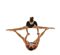 Acrobatics. Man and woman doing splits in support