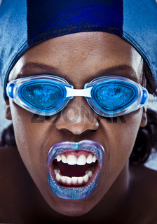 black girl wearing swimmin googles and hat with violet lips. artistic make-up shoot