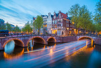 Bridge over Emperor's canal in Amsterdam, The Netherlands at twilight. HDR image