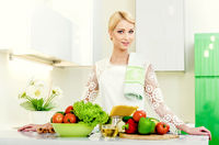 Young woman in the kitchen.Healthy Food. Dieting Concept. Healthy Lifestyle. Cooking At Home.