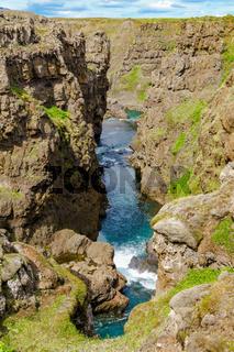 View of river at Kolugljufur Canyon