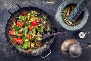 Indian Vegetable Curry Fry with Eggplant and Sweet Peppers as close-up in a in a frying pan