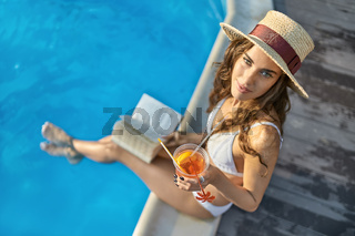 Model near swimming pool outdoors
