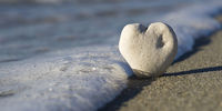 stone heart on a beach