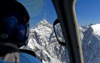 Anflug im Helikopter auf den Gipfel Jungfrau