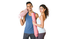 Young man and woman holding yoga mat