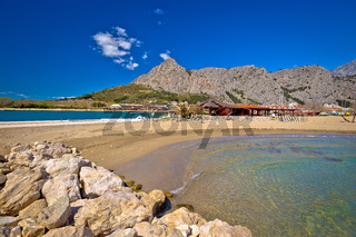 Town of Omis sand beach and Biokovo mountain coastline view