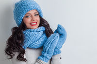 Woman in winter hat, scarf and mittens