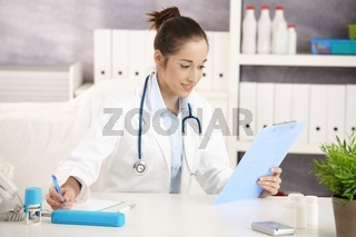 Doctor doing paperwork at office