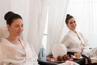 Pretty young girls in bathrobes shot in spa saloon