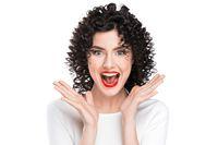 Woman screaming amazed in joy