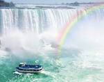 Rainbow and tourist boat at Niagara Falls
