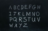 Alphabet letters written in chalk
