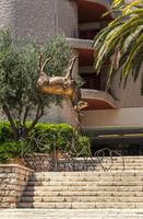 Sculpture of a deer, standing on the horns. Marseille