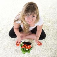 pregnant woman eating vegetables