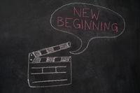 Movie clapper with speech bubble on chalkboard