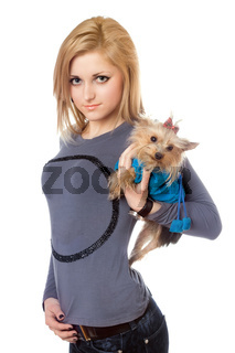 Pretty blonde posing with puppy. Isolated on white