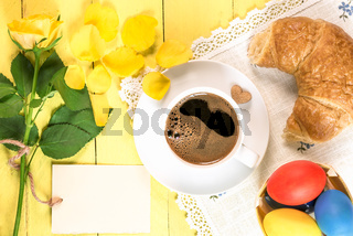 Coffee with pastry and Easter eggs