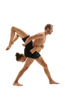 Paired gymnastics. Man and girl perform support