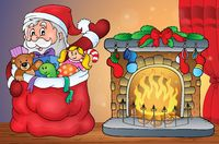 Santa Claus with gifts by fireplace