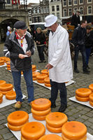 farmer, left, and a cheese merchant bargain over the price of Gouda cheese,cheese market Gouda