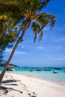 white sand beach and pier on the lagoon in Moorea Island