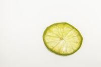 Lime slice against white background