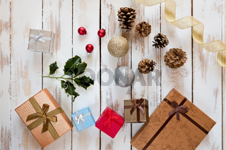 Christmas presents and decorations over a rustic wooden table