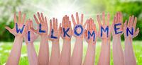 Word Willkommen Means Welcom On Hands, Sunny Meadow