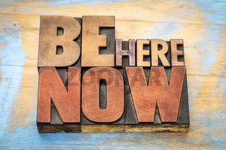 Be here now word abstract in wood type
