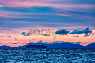 Sea sunset with criuse ship