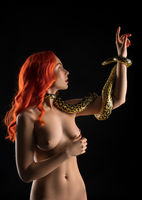 Nude red-haired girl with python isolated shot