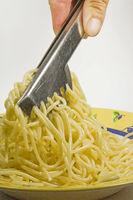 Spaghetti with spaghetti tongs