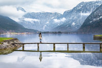 Woman on a deck over an alpine lake