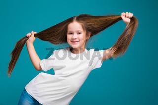Cute girl in tee shirt with long hair