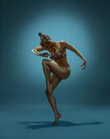Gold skin woman dancing in studio