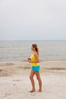 Young woman running on the beach