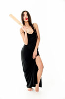 Young beautiful woman in a black dress with a baseball bat on a white background