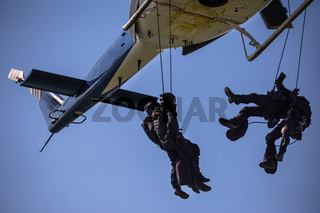 Special forces team helicopter rope jump