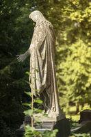 old Jesus sculpture in a park