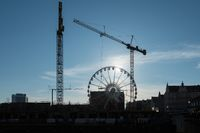 Cranes erecting new apartments near old town Gdansk