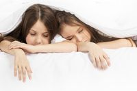 Two children sleeping in bed