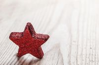 Red star on wooden background