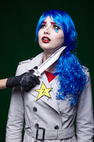 Female with knife near throat. Portrait of young woman in comic  pop art make-up style