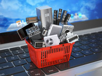E-commerce online shopping or delivery concept. Home appliance in shopping cart on the laptop keyboard. 3d